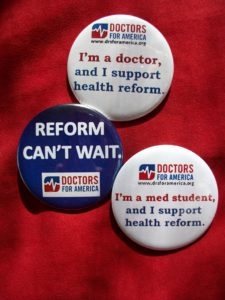 """DFA badges that read """"I'm a doctor, and I support health reform""""; """"Reform can't wait""""; and """"I'm a med student, and I support health reform"""""""